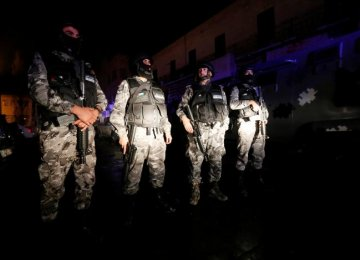 Jordanian policemen operate in the vicinity of Karak Castle, where armed gunmen carried out an attack, in the city of Karak, Jordan, on Dec. 18.