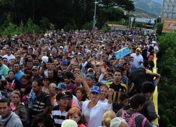 Thousands of Venezuelans cross into Colombia to shop for scarce food and medicine.
