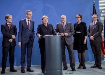 German Chancellor Angela Merkel (3rd L) gives a press conference on November 2, 2016 at the Chancellery in Berlin as she is handed over the annual report on the country's economic development by members of the German Council of Economic Experts  (L-R) Volker Wieland, Peter Bofinger, (Merkel), Christoph M Schmidt (the council's chairman), Isabel Schnabel and Lars P Feld.
