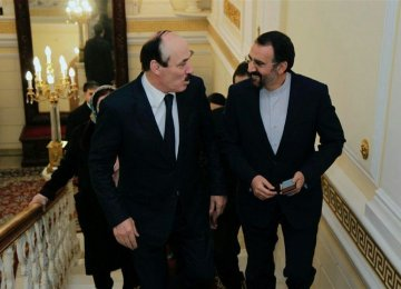 Head of the Republic of Dagestan Ramazan Abdulatipov  (L) talks with Iran's Ambassador to Russia Mehdi Sanaei in Moscow on Nov. 5.