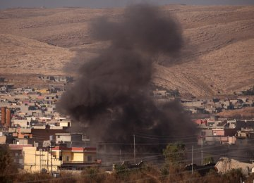 Smoke rises during clashes between Peshmerga forces and IS militants in the town of Bashiqa, east of Mosul, Iraq, on Nov. 7.