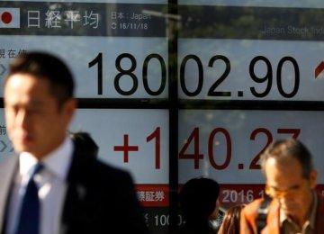 Japan's Nikkei average outside a brokerage in Tokyo.