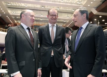 Mario Draghi (R), President of the ECB, Martin Zielke, Chairman of the Board of the Commerzbank (C) and John Cryan, CEO of the Deutsche Bank attend the European Banking Congress EBC in Frankfurt, Germany, on November 18.