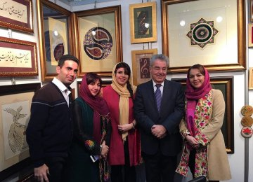Heinz Fischer, the former president of Austria (second R) visited the artworks of Mitra Osanloo (second L) and Mehrafarin Akbari (C)  at Iran's pavilion at the Vienna International Book Fair.