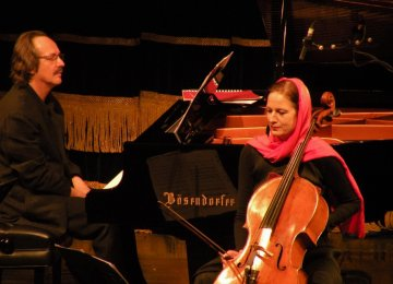 François Couturier (L) and Anja Lechner at the performance of Tarkovsky Quartet at Tehran's Vahdat Hall in 2013.