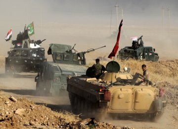 Iraqi forces deploy in the area of al-Shourah, some 45 kms south of Mosul, as they advance towards the city to retake it from the IS group, on October 17.
