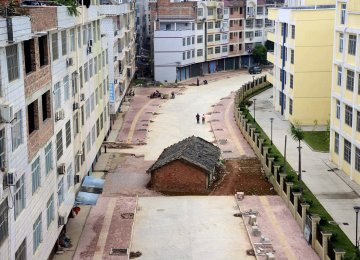 "Despite the surge in property sales, overall housing inventory remains a major issue across China. A ""nail house"", the last building  in the area, sits in the middle of a road under construction in Nanning, Guangxi Zhuang Autonomous Region."
