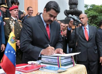 Nicolas Maduro attends a ceremony to sign off the 2017 national budget.