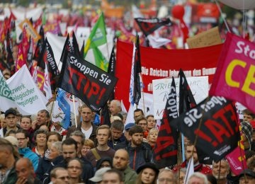 Activists rally for a demonstration against the massive transatlantic trade deals CETA and TTIP in Berlin.