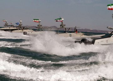 IRGC Boats Monitor US Warship