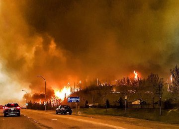 Raging Canada Fire Forces Thousands to Flee