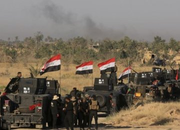 Iraqi Army Moves Into Fallujah as IS Hits Back