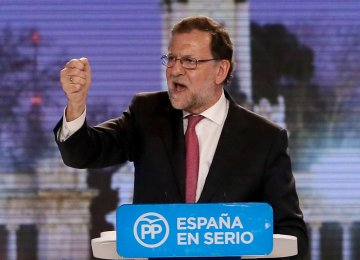 Spain Conservatives Win Vote,  But Political Landscape Fractured