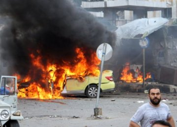 IS Claims Responsibility for Deadly Blasts in Syrian Cities