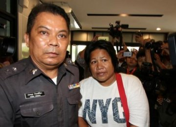 Thai Mother Charged Over One-Word Facebook Post