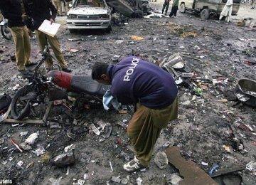 Twin Blasts Kill Police Officer  in Pakistan