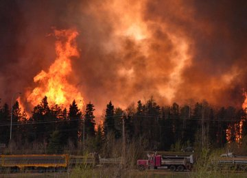 Oil Firms Warn of Output Cut After Canada Wildfires