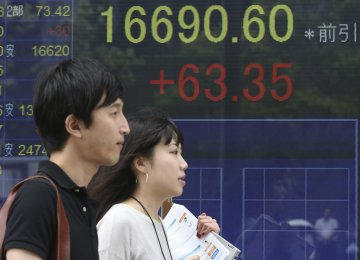 Shares Rise on Global Growth Promises