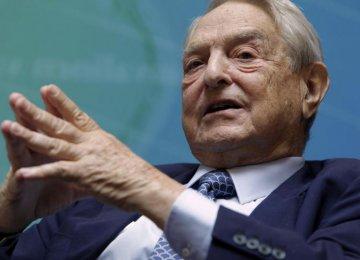 Soros Slashes US Stocks, Buys $264m Gold Stake