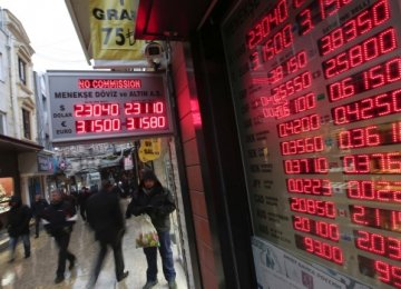 A board shows exchange rates at a foreign currency shop in central Istanbul.