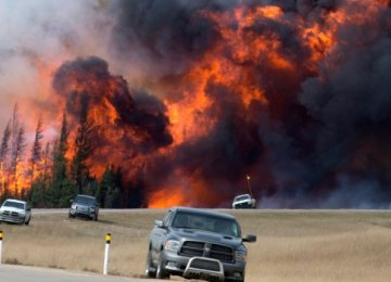 Wildfires Drag Canada's May GDP Down to Lowest in 7 Years