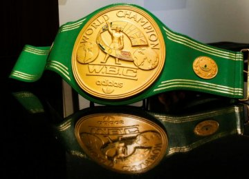The iconic 'Rumble in the Jungle' belt of Muhammad Ali is displayed for auction at Heritage Auctions House in Manhattan, New York. (Photo: Reuters)