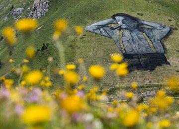 French Artist Paints Giant Hillside Portrait