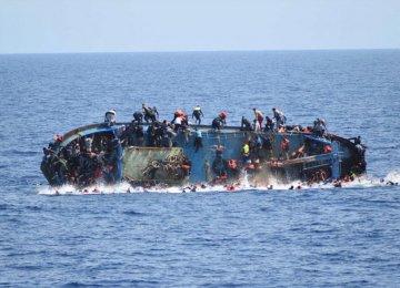 Dozens Feared Drowned as Migrant Boat Sinks Off Libya