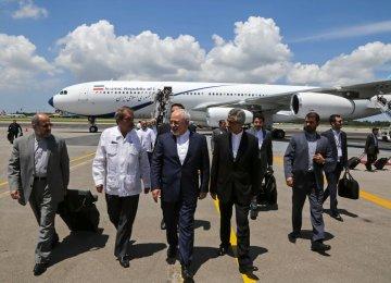 Foreign Minister Mohammad Javad Zarif (C) arrives in Havana.
