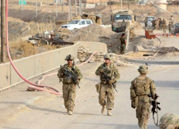 US soldiers walk on a bridge within the town of Gwer in northern Iraq on August 31, 2016. (File Photo)