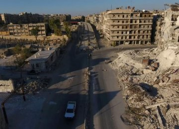 A still image taken on September 27, 2016, from a drone footage obtained by Reuters shows damaged buildings  in a militant-held area of Aleppo, Syria.