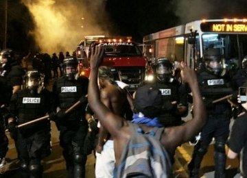 US Police Injured in Protests After Black Man Shot