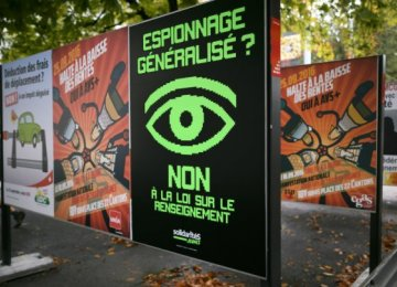 """A poster that translates as """"Widespread spying? No to the Law on Intelligence""""  on September 16, in Geneva, Switzerland."""