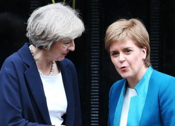 British Prime Minister Theresa May (L) and Scottish First Minister Nicola Sturgeon