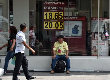 The battered Mexican peso has tumbled to historic new lows in recent days, nearing a psychological barrier of 20 pesos to  the US dollar and causing anxiety on the streets and at businesses.