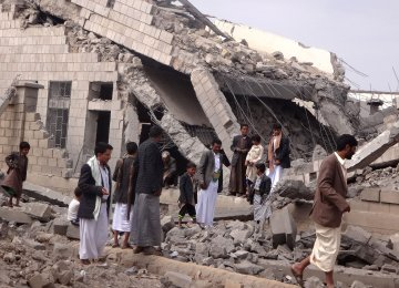 Yemenis inspect the rubble of a school destroyed by a Saudi-led air strike in Saada province on September 14.