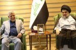 Moqtada al-Sadr (R) meets with Hadi al-Amiri, leader of  the Al-Fatih bloc, on May 20.