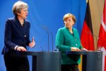 British Prime Minister Theresa May (L) and German Chancellor Angela Merkel attend a news conference after talks in Berlin on Feb. 16.