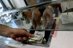 Currently, each US dollar is reportedly being traded for as much as 75,000 rials in Tehran's black market.