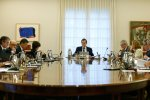 Spanish Prime Minister Mariano Rajoy (C) presides a crisis cabinet meeting at the Moncloa Palace in Madrid.