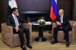 Russia's President Vladimir Putin (R) meets with his Syrian counterpart Bashar al-Assad in Sochi on November 20.