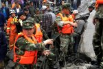 Rescuers search for survivors after a landslide in a mountain village in southwest Sichuan Province, June 24.