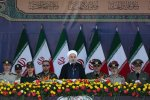Hassan Rouhani speaks during a ceremony  in Tehran on Saturday to mark the start of the 1980-88 Iran-Iraq war.