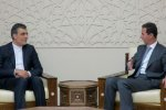 Deputy Foreign Minister for Arab and African Affairs Hossein Jaberi Ansari (L) meets Syrian President Bashar al-Assad in Damascus on July 20.