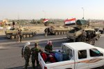 A convoy of Iraqi military trucks makes its way to Kirkuk on October 16.