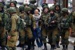 Blindfolded Fawzi al-Junaidi surrounded  by more than 20 Israeli forces