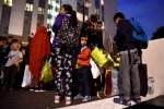 Residents are evacuated from the Taplow Tower residential block as a precautionary measure in north London, Britain, on June 23.