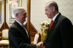 Turkish President Recep Tayyip Erdogan meets with US Defense Secretary Jim Mattis at the Presidential Palace  in Ankara on August 23.