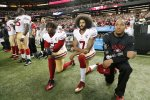 San Francisco 49ers quarterback Colin Kaepernick (7) and outside linebacker Eli Harold (58) kneel during the playing of the national anthem before an NFL football game against the Atlanta Falcons in Atlanta on Dec. 18, 2016.