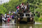 Military forces transfer people to rescue camps in Matara,  Sri Lanka, on May 28.